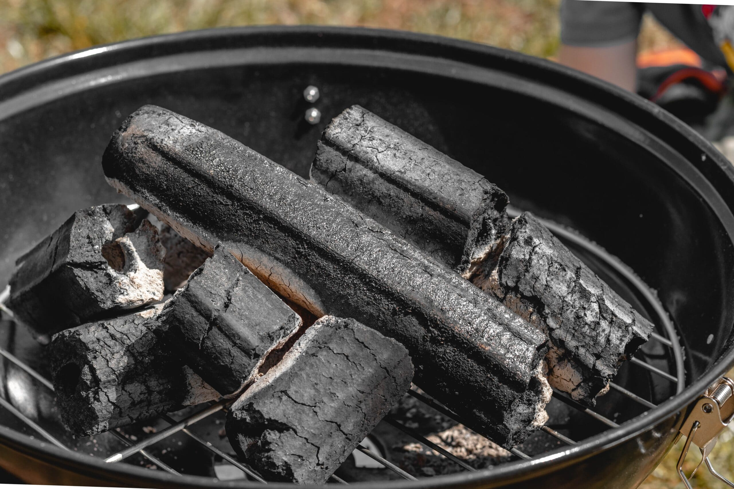 kettle grill with burning charcoal