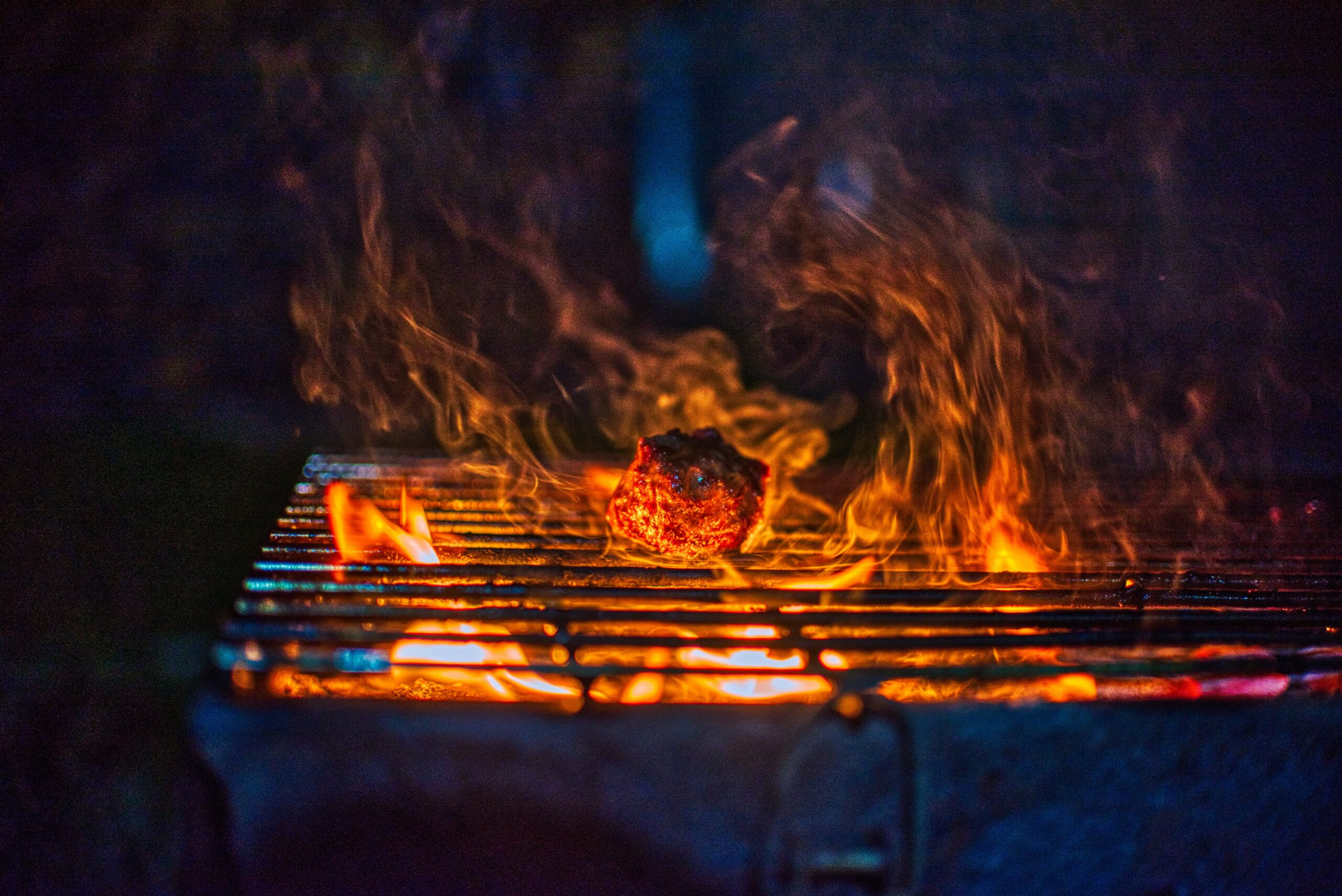 fire on black charcoal grill