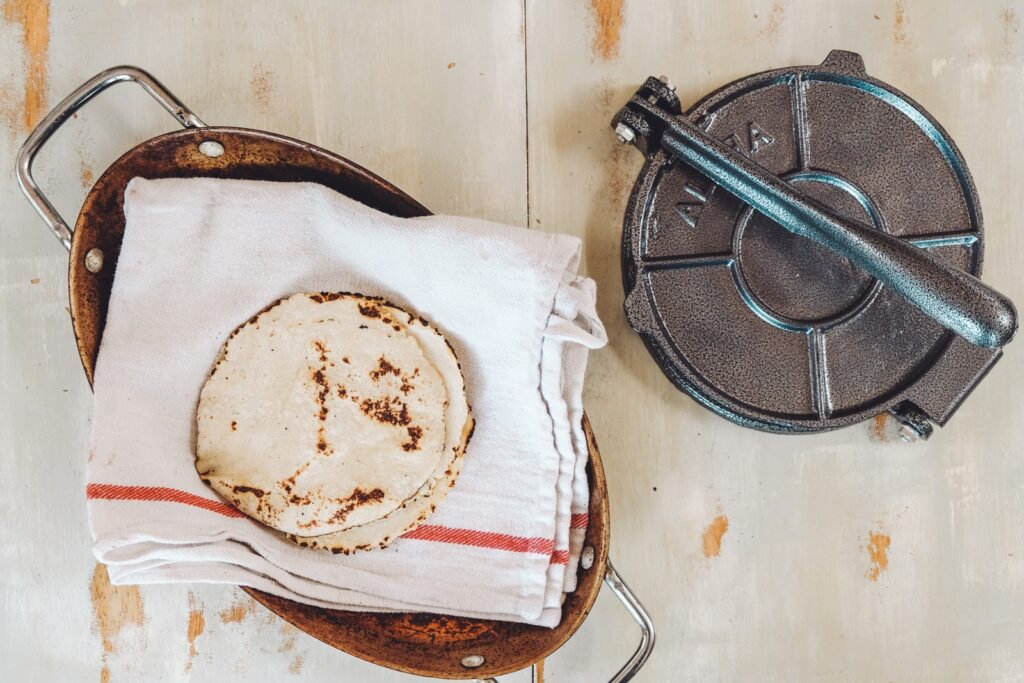 baked roti's on towel by roti maker