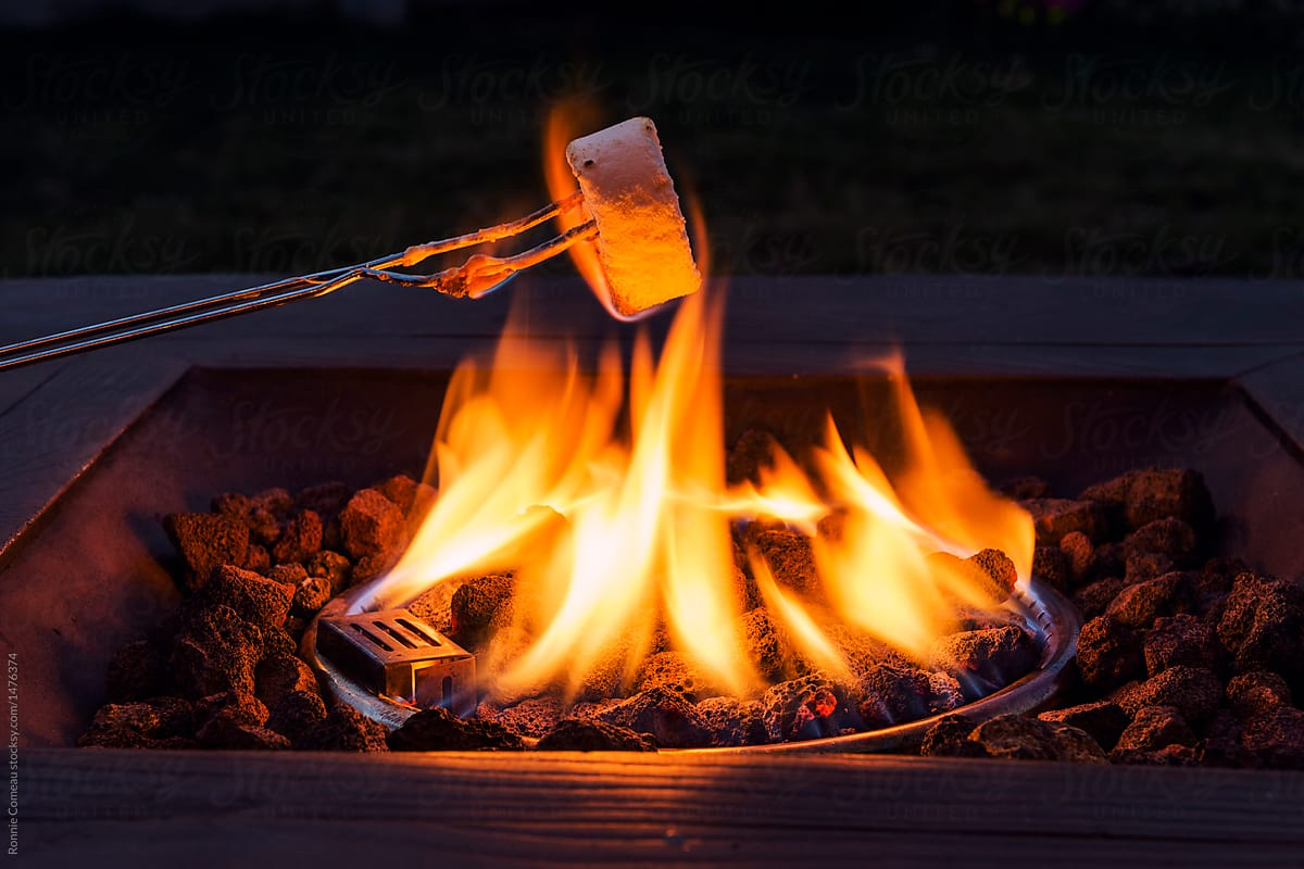 Roasting marshmallows over propane fire pits